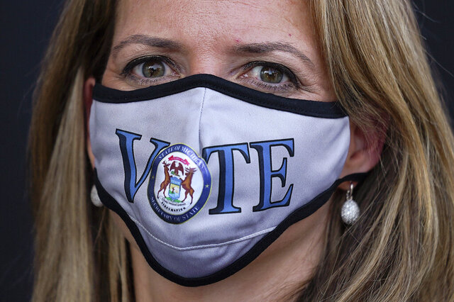 FILE - In this Sept. 24, 2020, file photo, Michigan Secretary of State Jocelyn Benson wears a mask before talking about voting and the upcoming elections in Detroit. Benson said Tuesday, Oct. 20, 2020, that the 1.5 million people with absentee ballots still in hand should put them in a drop box or take them to their local clerk's office rather than use the mail with two weeks to go until the presidential election. (AP Photo/Paul Sancya, File)