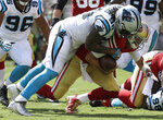 FILE - In this Sept. 10, 2017, file photo, Carolina Panthers defensive end Julius Peppers (90) tackles San Francisco 49ers quarterback Brian Hoyer during the first half of an NFL football game in Santa Clara, Calif. Peppers announced his retirement, Friday, Feb. 1, 2019, after 17 NFL seasons, nine Pro Bowl appearances and six All-Pro selections. (AP Photo/Marcio Jose Sanchez, File)