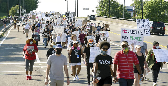 Thousands participated in a Black Lives Matter march through Alcoa and Maryville, Tenn., Sunday June 7, 2020. The course of the march led attendees from the Martin Luther King Jr. Community Center to the Blount County Courthouse inn Blount County . (Scott Keller/The Daily Times via AP)