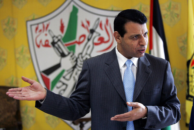 FILE - In this Jan. 3, 2011 file photo, Mohammed Dahlan speaks during an interview at his office in the West Bank city of Ramallah. Palestinian security forces have detained dozens of supporters of the rival to President Mahmoud Abbas who is based in the United Arab Emirates. Dahlan, a former senior Palestinian official who was banished from the West Bank in 2010 after a falling-out with Abbas, has denied any role in the UAE's agreement to normalize ties with Israel, which the Palestinians view as a betrayal of their cause. His political movement said Monday, Sept. 21, 2020 that dozens of its members have been detained or summoned for questioning by Palestinian security forces in the West Bank in recent days. (AP Photo/Majdi Mohammed, File)