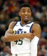 Utah Jazz guard Donovan Mitchell (45) talks to the Los Angeles Lakers' bench during the first half of an NBA basketball game Friday, Jan. 11, 2019, in Salt Lake City. (AP Photo/Rick Bowmer)