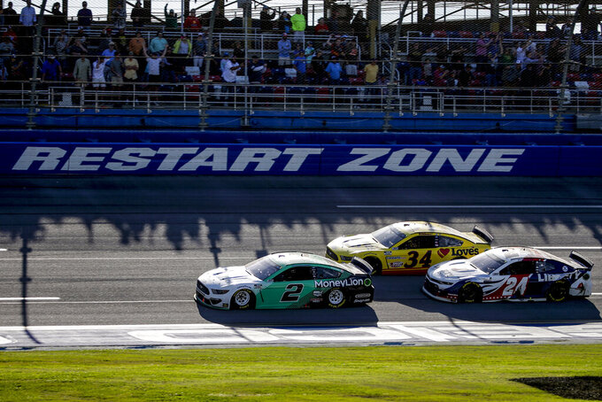 NASCAR Cup Series driver Brad Keselowski (2) leads the way to the finish line to win the Geico 500 NASCAR Sprint Cup auto race at Talladega Superspeedway Sunday, April 25, 2021 in Talladega, Ala. (AP Photo/Butch Dill)