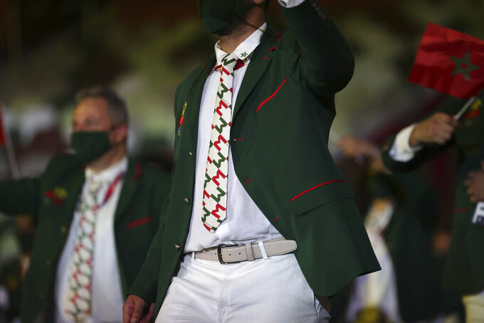 A member from Team Morocco arrives during the opening ceremony in the Olympic Stadium at the 2020 Summer Olympics, Friday, July 23, 2021, in Tokyo, Japan. (Hannah McKay/Pool Photo via AP)