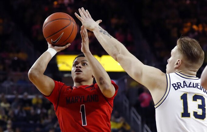 Maryland guard Anthony Cowan Jr. (1) shoots as Michigan forward Ignas Brazdeikis (13) defends during the first half of an NCAA college basketball game, Saturday, Feb. 16, 2019, in Ann Arbor, Mich. (AP Photo/Carlos Osorio)