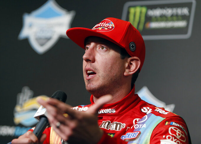 Kyle Busch answers questions after winning the NASCAR Cup Series auto race at ISM Raceway, Sunday, March 10, 2019, in Avondale, Ariz. (AP Photo/Ralph Freso)