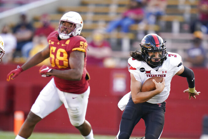 Texas Tech quarterback Henry Colombi (3) runs from Iowa State defensive end Eyioma Uwazurike (58) during the second half of an NCAA college football game, Saturday, Oct. 10, 2020, in Ames, Iowa. Iowa State won 31-15. (AP Photo/Charlie Neibergall)
