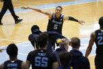 Marquette guard Greg Elliott (5) celebrates following the team's NCAA college basketball game against North Carolina in Chapel Hill, N.C., Wednesday, Feb. 24, 2021. (AP Photo/Gerry Broome)