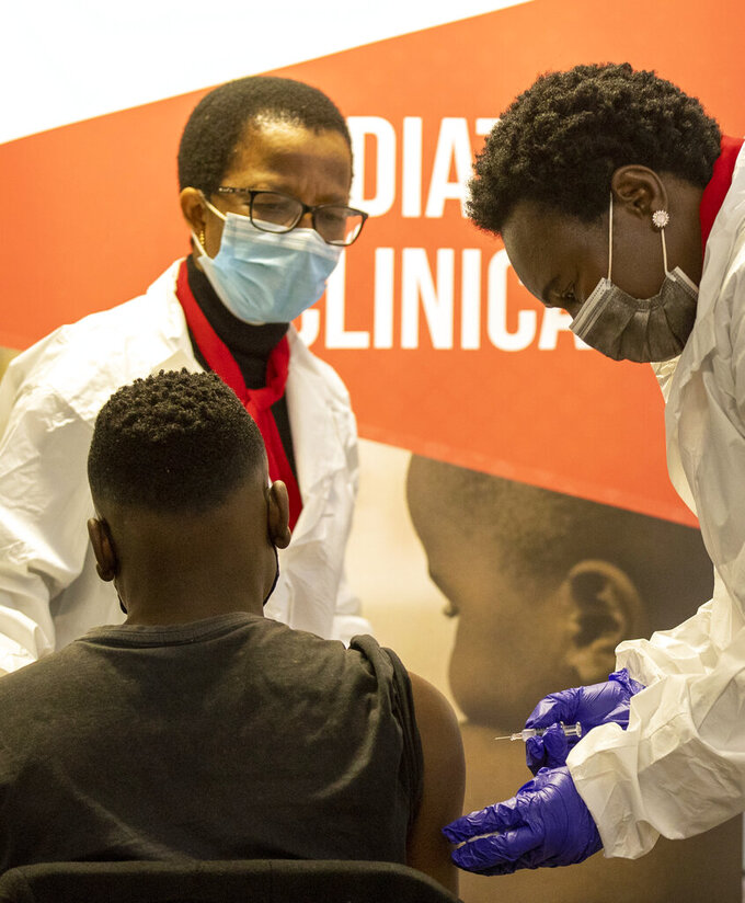 A minor receives Sinovac vaccine jab from a healthcare worker in Pretoria, South Africa, Friday, Sept. 10, 2021. South Africa starts phase three Covid-19 clinical trials investigating the efficacy of the Sinovac vaccine in children on Friday. (AP Photo/Themba Hadebe)