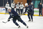 Seattle Kraken players take part in a practice session, Thursday, Sept. 9, 2021, during a media event for the grand opening of the Kraken's NHL hockey practice and community facility in Seattle. (AP Photo/Ted S. Warren)