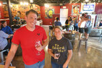Kyle Gregore and Tasha Davis, along with Rick Davis and Gary Lipkos, created Stained Glass Wine House, a wine bar in downtown Gretna with a self-serve approach through computerized wine dispensers. (Ian McNulty/The Times-Picayune/The New Orleans Advocate via AP)