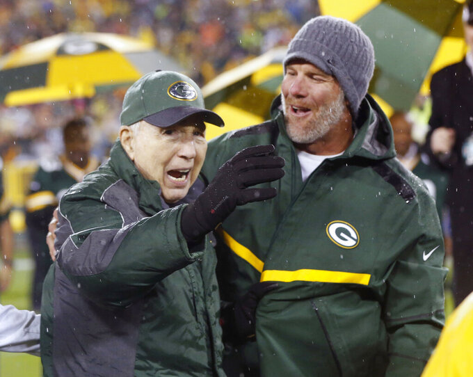 FILE - In this Thursday, Nov. 26, 2015, file photo, Brett Favre, right, smiles at Bart Starr during a ceremony at halftime of an NFL football game between the Green Bay Packers and Chicago Bears in Green Bay, Wis. Starr, the Green Bay Packers quarterback and catalyst of Vince Lombardi's powerhouse teams of the 1960s, has died. He was 85. The Packers announced Sunday, May 26, 2019, that Starr had died, citing his family. He had been in failing health since suffering a serious stroke in 2014. (AP Photo/Mike Roemer, File)