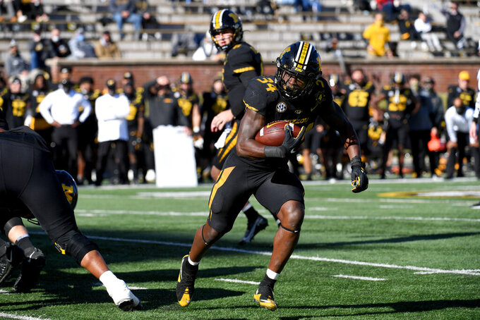 Missouri running back Larry Rountree III scores on a touchdown run during the first half of an NCAA college football game against Arkansas Saturday, Dec. 5, 2020, in Columbia, Mo. (AP Photo/L.G. Patterson)
