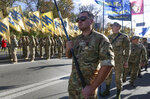 Soldiers of Ukrainian right-wing paramilitary Azov National Corps with their flags attend a rally marking Defender of Ukraine Day in centre Kyiv, Ukraine, Wednesday, Oct. 14, 2020. (AP Photo/Efrem Lukatsky)