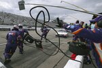 The pit crew scrambles to work as driver Denny Hamlin rolls in for a pitstop during a NASCAR Cup Series auto race, Sunday, Aug. 2, 2020, at the New Hampshire Motor Speedway in Loudon, N.H. (AP Photo/Charles Krupa)