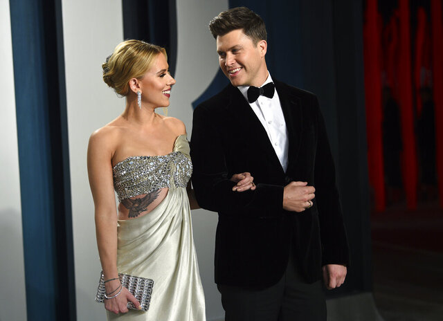 FILE - In this Feb. 9, 2020 file photo, Scarlett Johansson, left, and Colin Jost arrive at the Vanity Fair Oscar Party in Beverly Hills, Calif.  Meals on Wheels America announced Thursday on Instagram that Johansson and Jost married over the weekend in an intimate ceremony. (Photo by Evan Agostini/Invision/AP, FIle)