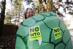 In this photo taken Monday, Nov. 25, 2019, Lisa Wathne holds an original sea turtle costume like the one she wore, made for protesters at the World Trade Organization (WTO) demonstrations in Seattle 20 years earlier, in Lake Forest Park, Wash. Wathne and other demonstrators wore the cardboard turtle shells to protest WTO policies, including one interpreted by protesters as disregarding the plight of turtles killed by shrimp nets. A wide array of issues brought tens of thousands of protesters to Seattle 20 years ago Saturday, with one unifying theme: concern that the World Trade Organization, a then-little-known body charged with regulating international trade, threatened them all. (AP Photo/Elaine Thompson)