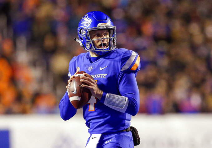 Boise State quarterback Brett Rypien looks for a receiver during the first half of the team's NCAA college football game against Utah State on Saturday, Nov. 24, 2018, in Boise, Idaho. (AP Photo/Steve Conner)