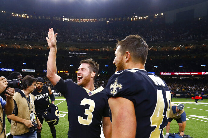 New Orleans Saints kicker Wil Lutz (3) celebrates after an NFL football game against the Houston Texans in New Orleans, Monday, Sept. 9, 2019. Lutz kicked a 58 yard field goal at the end of regulation, and the Saints won 30-28. (AP Photo/Butch Dill)