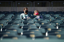 Philadelphia Eagles' fans sit in the stands before an NFL football game against the Baltimore Ravens, Sunday, Oct. 18, 2020, in Philadelphia. (AP Photo/Derik Hamilton)