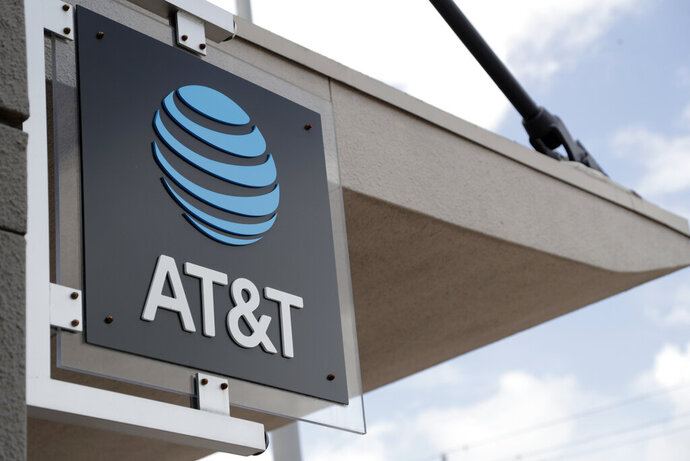 FILE - In this July 18, 2019, file photo, a sign is displayed at an AT&T retail store in Miami. Activist hedge fund manager Elliott Management is making a new $3.2 billion investment in AT&T, saying the company could be valued at more than $60 a share by 2021's end. AT&T stock jumped nearly 6% to $38.31 in Monday, Sept. 9, premarket trading. (AP Photo/Lynne Sladky, File)