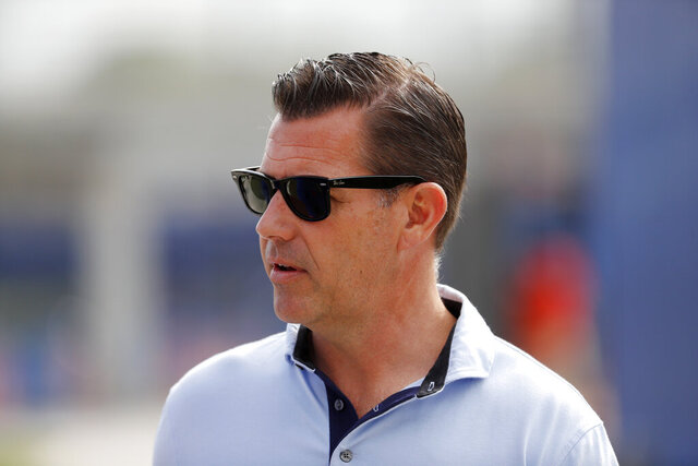 "FILE - In this Feb. 15, 2020, file photo, New York Mets general manager Brodie Van Wagenen attends baseball spring training for the team in Port St. Lucie, Fla. As baseball's amateur draft was winding down, the Mets selected Eric Orze — a two-time cancer survivor. ""To go through what he went through a couple of years ago when it would have been easy to stop playing baseball or lose his purpose, and he never did,"" Van Wagenen said. ""And so, he's motivated and he wants the challenge of professional baseball and we're glad to be able to give him that opportunity."" (AP Photo/Jeff Roberson, File)"