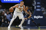 Denver Nuggets' Nikola Jokic controls the ball against Minnesota Timberwolves' Shabazz Napier in the first half of an NBA basketball game Monday, Jan. 20, 2020, in Minneapolis. (AP Photo/Stacy Bengs)