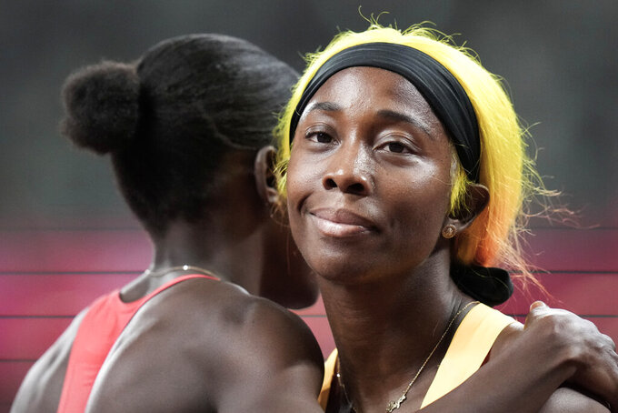 Shelly-Ann Fraser-Pryce, of Jamaica, wins a women's 100-meter semifinal at the 2020 Summer Olympics, Saturday, July 31, 2021, in Tokyo. (AP Photo/Petr David Josek)