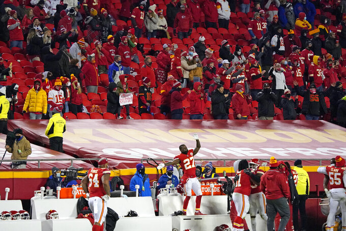 Kansas City Chiefs cornerback Rashad Fenton celebrates on the bench during the second half of the AFC championship NFL football game against the Buffalo Bills, Sunday, Jan. 24, 2021, in Kansas City, Mo. (AP Photo/Jeff Roberson)