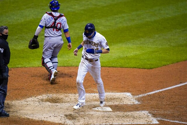 Milwaukee Brewers' Christian Yelich scores the game-winning run from third on a sacrifice fly by Ryan Braun during the ninth inning of a baseball game against the Chicago Cubs Friday, Sept. 11, 2020, in Milwaukee. The Brewers won 1-0. (AP Photo/Morry Gash)