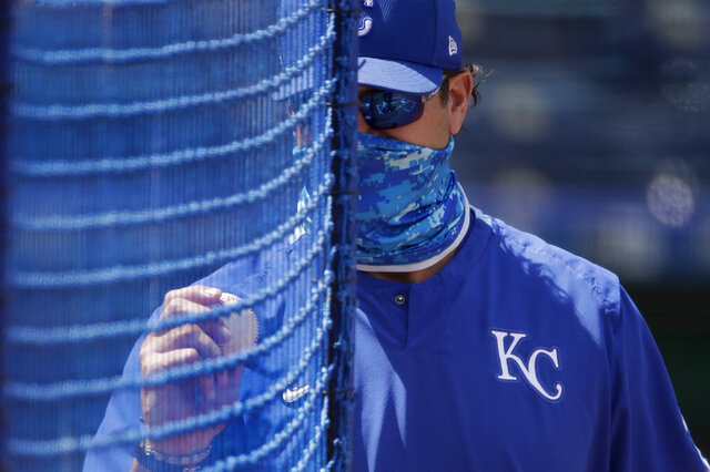 Kansas City Royals manager Mike Matheny watches baseball practice at Kauffman Stadium on Thursday, July 9, 2020, in Kansas City, Mo. (AP Photo/Charlie Riedel)