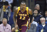 Iona's Tajuan Agee reacts after scoring a basket in the first half of an NCAA college basketball game against Connecticut, Wednesday, Dec. 4, 2019, in Storrs, Conn. (AP Photo/Jessica Hill)