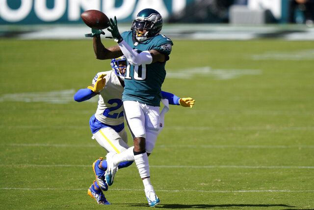 Philadelphia Eagles' DeSean Jackson, right, catches a pass against Los Angeles Rams' Troy Hill during the second half of an NFL football game, Sunday, Sept. 20, 2020, in Philadelphia. (AP Photo/Chris Szagola)