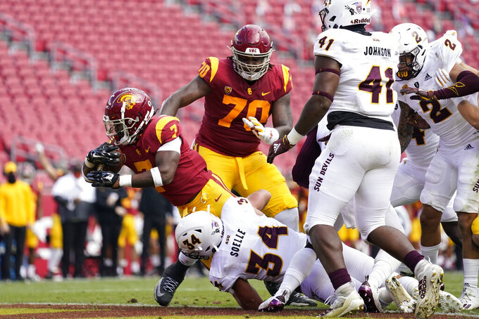 Southern California running back Stephen Carr (7) crosses the goal line for a touchdown against Arizona State during the first half of an NCAA college football game Saturday, Nov. 7, 2020, in Los Angeles. (AP Photo/Ashley Landis)