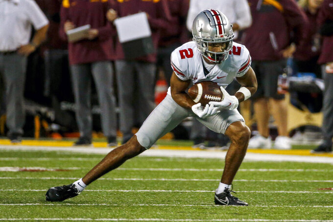Ohio State wide receiver Chris Olave (2) catches a pass against Minnesota in the second quarter of an NCAA college football game Thursday, Sept. 2, 2021, in Minneapolis. (AP Photo/Bruce Kluckhohn)