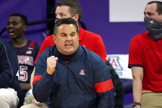 Arizona head coach Sean Miller motions toward the court in the first half of an NCAA college basketball game against Washington, Thursday, Dec. 31, 2020, in Seattle. (AP Photo/Elaine Thompson)