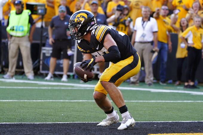 Iowa defensive back Riley Moss (33) recovers a fumble in the end zone during the second half of an NCAA college football game against Kent State, Saturday, Sept. 18, 2021, in Iowa City, Iowa. Iowa won 30-7. (AP Photo/Charlie Neibergall)