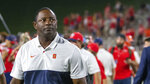 Syracuse coach Dino Babers looks at the scoreboard after the team's win over Liberty during an NCAA college football game in Lynchburg, Va., Saturday, Aug. 31, 2019. (AP Photo/Matt Bell)