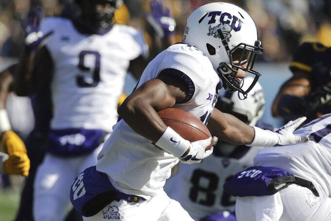 TCU wide receiver Derius Davis (12) runs the ball during the first half of an NCAA college football game against West Virginia, Saturday, Nov. 10, 2018, in Morgantown, W.Va. (AP Photo/Raymond Thompson)