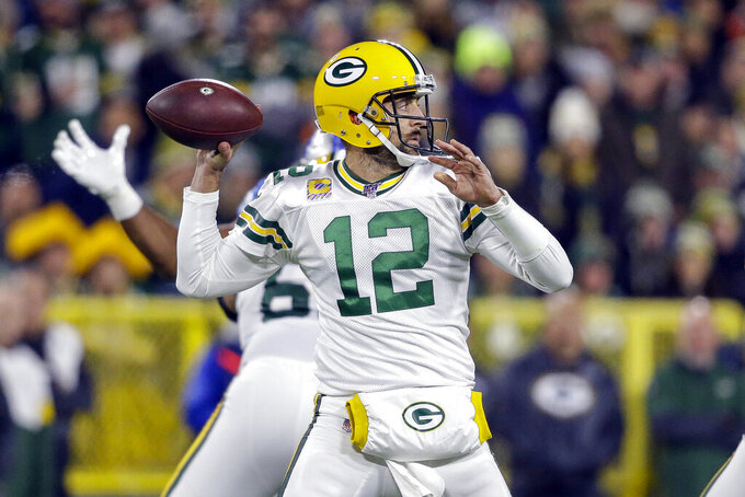 Green Bay Packers quarterback Aaron Rodgers drops back to pass during the first half of an NFL football game against the Detroit Lions, Monday, Oct. 14, 2019, in Green Bay, Wis. (AP Photo/Jeffrey Phelps)