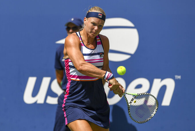 FILE - In this Aug. 31, 2019, file photo, Kiki Bertens, of the Netherlands, returns a shot to Julia Goerges, of Germany, during round three of the U.S. Open tennis championships in New York. Two more top-10 women -- Elina Svitolina and Kiki Bertens -- will miss the U.S. Open, joining No. 1-ranked Ash Barty in skipping the Grand Slam tennis tournament during the coronavirus pandemic. (AP Photo/Sarah Stier)