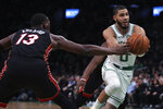 Boston Celtics forward Jayson Tatum (0) drives to the basket against Miami Heat center Bam Adebayo (13) during the first half of an NBA basketball game in Boston, Wednesday, Dec. 4, 2019. (AP Photo/Charles Krupa)
