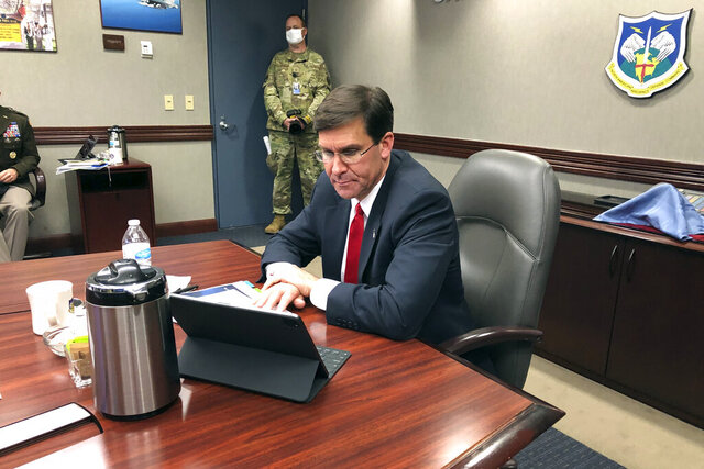 Defense Secretary Mark Esper speaks by video teleconference from U.S. Northern Command in Colorado Springs, Colo., on Thursday, May 7, 2020, with military medical specialists at civilian hospitals in New York and Connecticut. (AP Photo/Robert Burns)