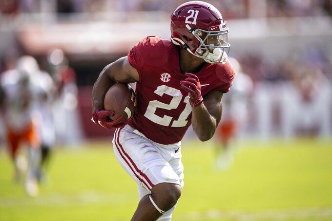 Alabama running back Jase McClellan (21) returns a blocked punt for a touchdown against Mercer during the first half of an NCAA college football game, Saturday, Sept. 11, 2021, in Tuscaloosa, Ala. (AP Photo/Vasha Hunt)