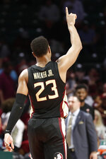 Florida State guard M.J. Walker (23) gestures after a win against Miami in an NCAA college basketball game on Saturday, Jan. 18, 2020, in Coral Gables, Fla. (AP Photo/Brynn Anderson)