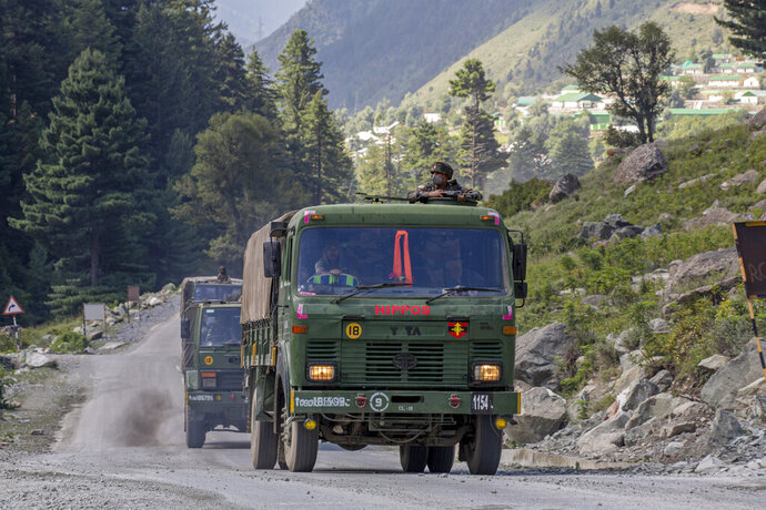 An Indian army convoy moves on the Srinagar- Ladakh highway at Gagangeer, northeast of Srinagar, Indian-controlled Kashmir, Wednesday, Sept. 9, 2020. India's defense minister said Thursday, Sept. 17, the country faces challenges in its border dispute with China and urged Beijing to sincerely implement an understanding they reached previously to completely disengage forces in the Ladakh region. Rajnath Singh said in a statement in the upper house of Parliament that China has amassed troops and armaments in Ladakh in violation of bilateral agreements reached in 1990s and it was creating friction by trying unilaterally to alter the status quo in the region through aggressive postures. (AP Photo/ Dar Yasin)
