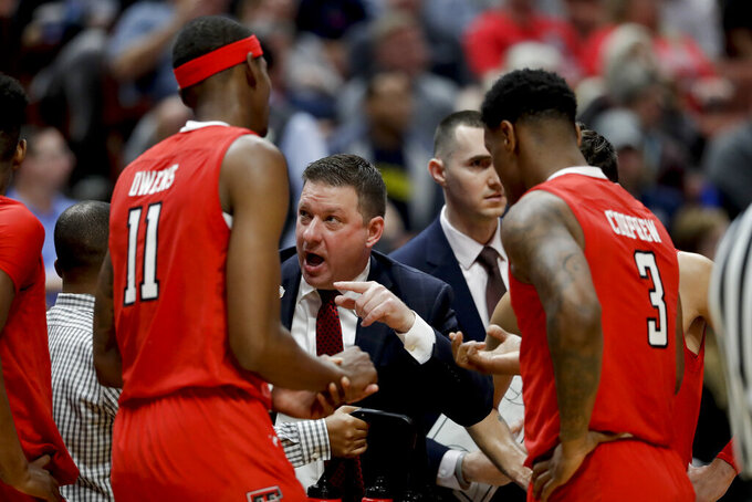 Texas Tech coach Chris Beard talks to his team during the first half against Michigan in an NCAA men's college basketball tournament West Region semifinal Thursday, March 28, 2019, in Anaheim, Calif. (AP Photo/Marcio Jose Sanchez)