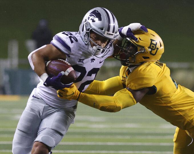 Kansas State running back Deuce Vaughn (22) is tackled Baylor linebacker Ashton Logan (34) in the first half of an NCAA college football game, Saturday, Nov. 28, 2020, in Waco, Texas. (Jerry Larson/Waco Tribune-Herald via AP)