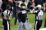 New Orleans Saints head coach Sean Payton talks to officials before challenging a ruling the field in the first half of an NFL football game against the Kansas City Chiefs in New Orleans, Sunday, Dec. 20, 2020. (AP Photo/Butch Dill)