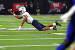 Arizona quarterback Gunner Cruz (9) tries to pass the ball against BYU during the second half of an NCAA college football game Saturday, Sept. 4, 2021, in Las Vegas. (AP Photo/David Becker)