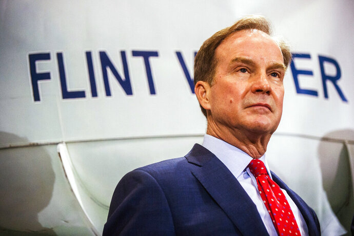 """FILE - In this June 14, 2017 file photo, Michigan Attorney General Bill Schuette fields questions from reporters in Flint, Mich., after announcing charges against five water officials with manslaughter related to their alleged failure to act during the Flint water crisis. In 2016, Schuette promised to investigate the Flint water scandal """"without fear or favor"""" and pledged that state regulators would be locked up for fudging data and misleading the public about lead in the poor city's pipes. Yet three years later, no one is behind bars. (Jake May/The Flint Journal-MLive.com via AP, File)"""